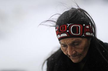 "In this Tuesday, Nov. 29, 2016 photo, Grandma Redfeather of the Sioux Native American tribe walks in the snow to get water at the Oceti Sakowin camp where people have gathered to protest the Dakota Access oil pipeline in Cannon Ball, N.D. ""It's for my people to live and so that the next seven generations can live also,"" said Redfeather of why she came to the camp. ""I think about my grandchildren and what it will be like for them."" (ANSA/AP Photo/David Goldman) [CopyrightNotice: Copyright 2016 The Associated Press. All rights reserved.]"